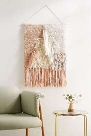 https://www.urbanoutfitters.com/fr-fr/shop/talla-textured-wall-hanging?category=homeware-sale&color=066